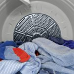 Clothes and towels in the dryer, photo.