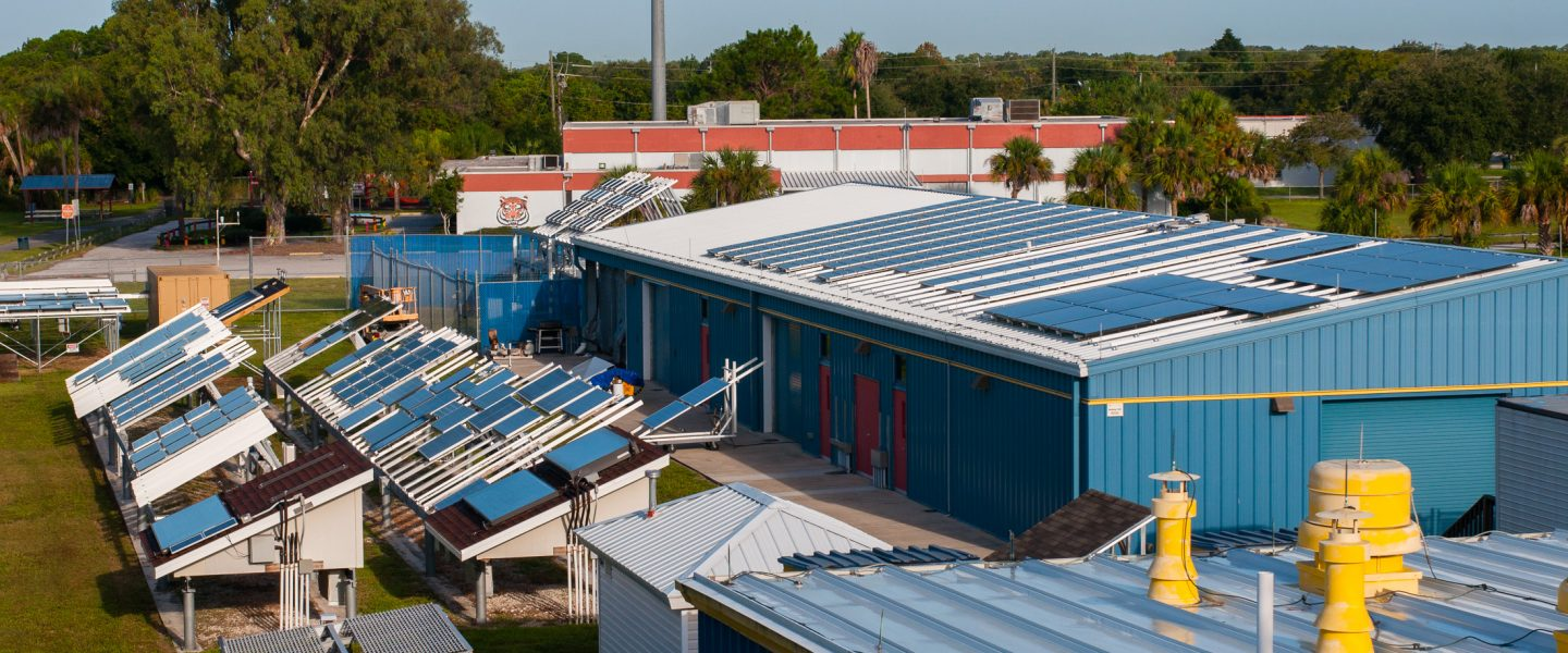 Elevated view of both ground mounted and roof mounted photovoltaic systems on top of laoratories, photo.