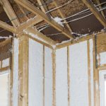 Dense packed insulation in unfinished construction framed wall