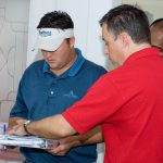 An instructor helping a student during an energy rater training course