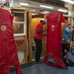 Students assemble a blower door in a class