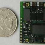 Single-chip DC to DC converter next to a quarter to indicate how small it is.