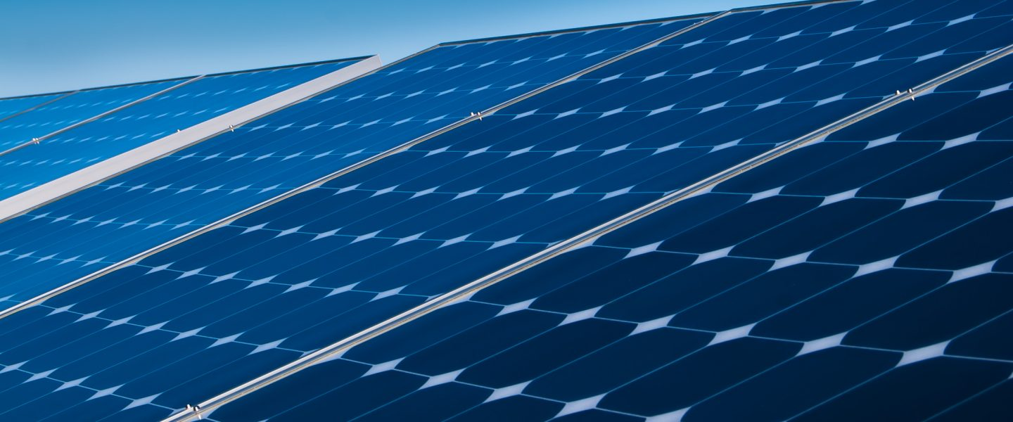 Photovoltaic panels close up with blue sky in background, photo.