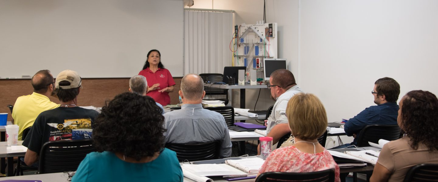 Instructor Tei Kucharski teaches an Introduction to Building Efficiency Performance, photo
