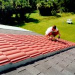 FSEC engineer John Sherwin color matches a condensation sensor installed on the red tile roof.