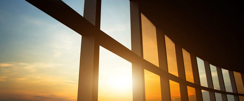 Large window panes with sun shining through.