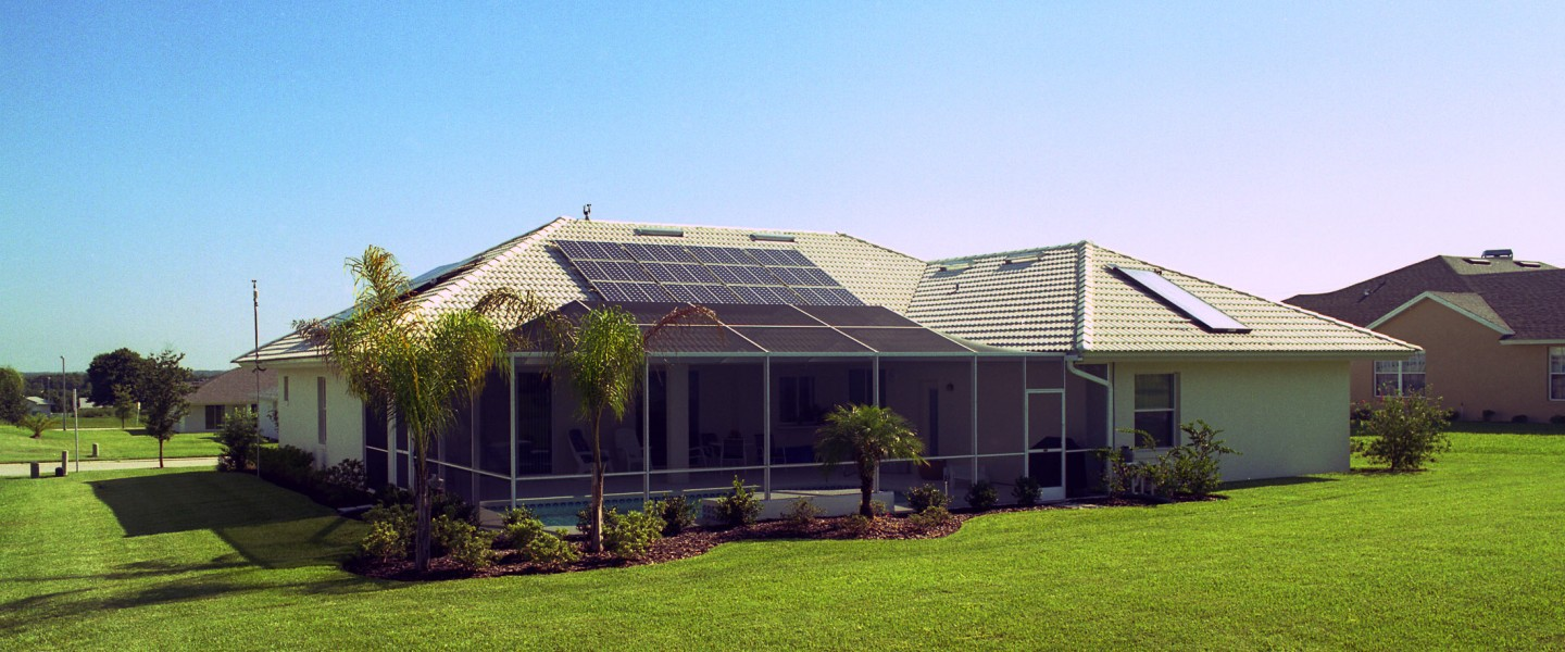 Zero Energy Home, or ZEH, in Lakeland Florida photo with pv and solar water heating on the roof