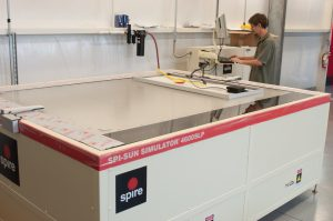 Researcher tests photovoltaic module on Spire solar simulator.