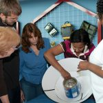 Teachers construct a solar cooker at a workshop photo