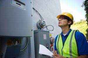 Maintenance worker reads meter of solar generation