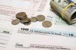 1040 tax form with us coins and bills photo