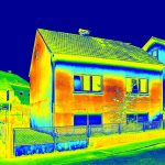 Infrared thermovision image showing lack of thermal insulation on house, used in continuing education training course.