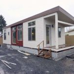 Newly constructed manufactured home with porch, photo.