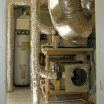 Testing of variable capacity heat pump and fixed capacity cooling and heating systems with foil-wrapped interior ducts, photo.