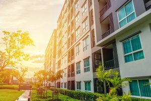 Modern apartment buildings or condo exteriors with sun shining on building.