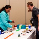Teachers working on a Rube Goldberg contraption at an EnergyWhiz workshop.