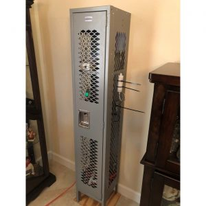 Indoor air monitoring station: freestanding gray school locker with monitoring equipment inside.