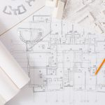 Workplace of architect with floor plans photo
