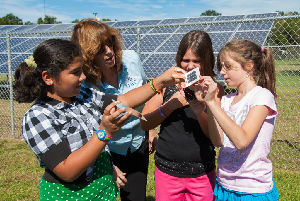 FSEC Energy Education Program Manager Susan Schleith helps school girls learn how PV works