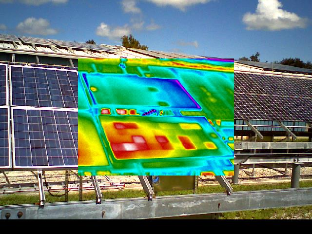 Infrared thermography image of two photovoltaic modules superimposed over photography of actual modules.