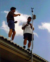 researchers install equipment on a roof