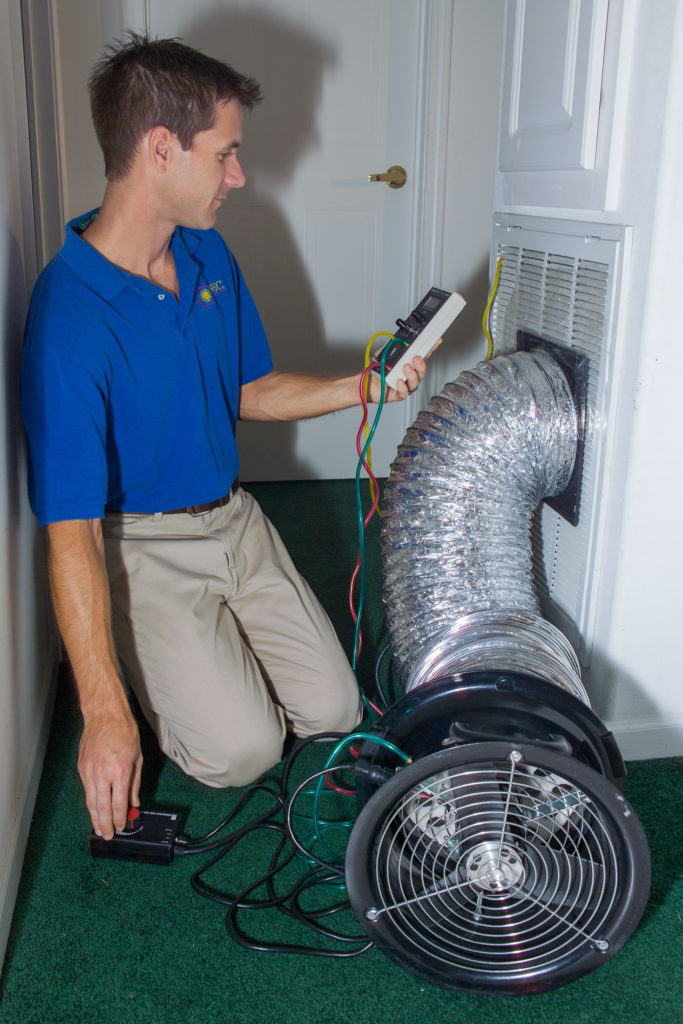 Eric Martin measures duct performance.